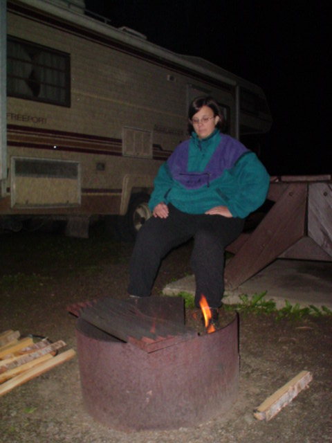 Laura at the campfire trying to keep warm