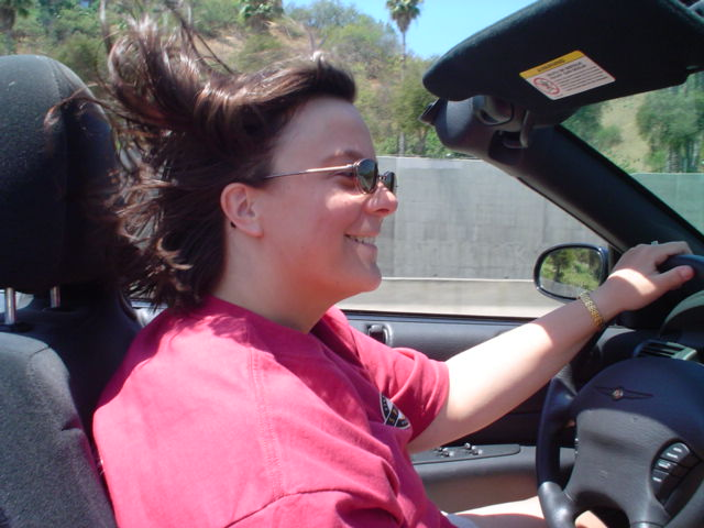 Laura enjoyed the wind in her hair.