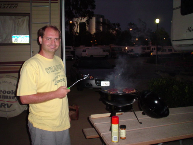 Joe is burning some steaks at the Golden Shore RV Park